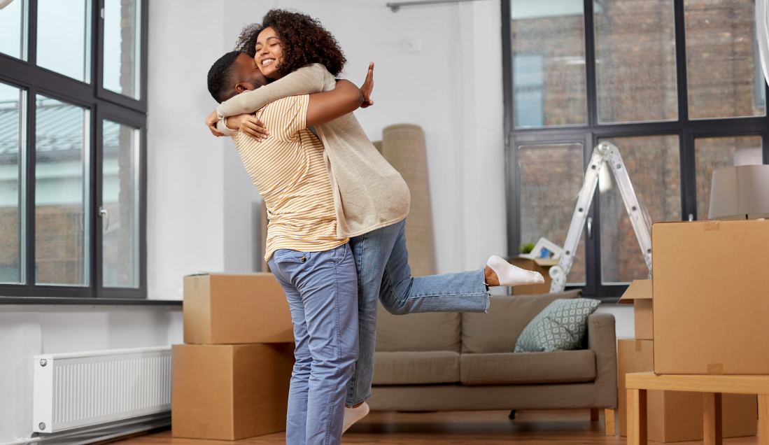 happy couple moving into their first home together, after getting advice from a mortgage broker. Evolution financial services